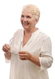 Senior woman with glasses in hand Royalty Free Stock Photography