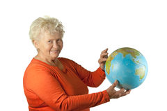 Senior woman with a globe Stock Photography