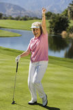 Senior Woman With Golf Club On Course Stock Image