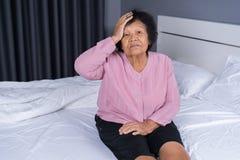 Senior woman got a headache on bed. Senior woman got a headache on a bed Stock Photography