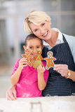 Senior woman granddaughter cookies Royalty Free Stock Photography