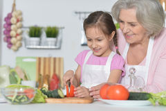 Senior woman with granddaughter cooking Royalty Free Stock Photo