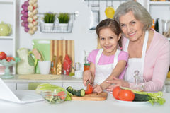 Senior woman with granddaughter cooking Royalty Free Stock Photography
