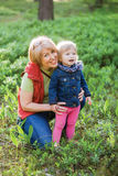 Senior woman with granddaughter. Family concept. Senior women playing with granddaughter at forest. Family love friendship concept Royalty Free Stock Photography
