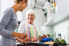 Senior woman/grandmother cooking in a modern kitchen Royalty Free Stock Image