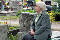 Senior woman in graveyard Royalty Free Stock Image