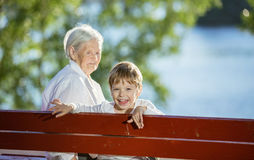 Senior woman and great grandson having fun outdoors Royalty Free Stock Photos