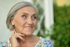 Senior woman in green park Royalty Free Stock Photo