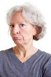Senior woman grimacing Royalty Free Stock Photos