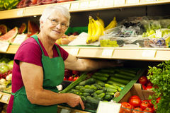 Senior woman in groceries store Royalty Free Stock Photos
