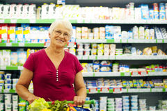 Senior woman in groceries store Stock Photos