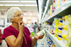 Senior woman in groceries store Stock Photography