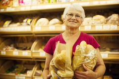 Senior woman in groceries store Royalty Free Stock Photography