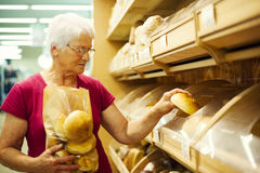 Senior woman in groceries store Royalty Free Stock Photo