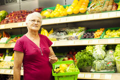 Senior woman in groceries store Royalty Free Stock Image