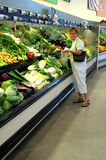 Senior woman grocery shopping Stock Images