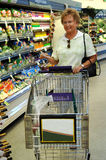 Senior woman grocery shopping Royalty Free Stock Photo