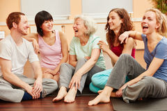 Senior woman and group laughing royalty free stock photo