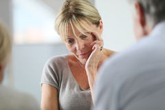 Senior woman at group therapy. Senior women attending group therapy royalty free stock photography