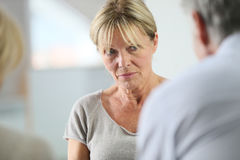 Senior woman in group therapy. Senior women attending group therapy Royalty Free Stock Photography