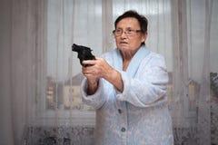 Senior woman with a gun Stock Photos