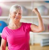 Senior woman at the gym Stock Photo