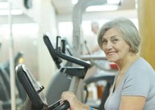 Senior woman in gym Stock Images