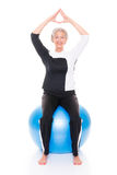 Senior woman gymnastic ball. Senior woman with gymnastic ball in front of white backgound Royalty Free Stock Images