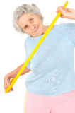 Senior woman gymnastic exercises with hoop Stock Photo