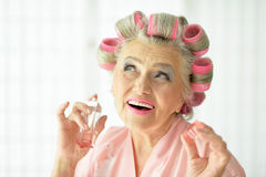 Senior woman in  hair rollers Stock Image