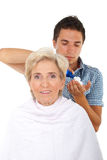 Senior woman in a hair salon with hairstylist Royalty Free Stock Photos