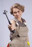 Senior woman with a hammer Stock Photography