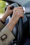 Senior woman hand on steering wheel Stock Images
