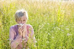 Senior woman with handkerchief in the grass Royalty Free Stock Photos