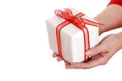 Senior woman hands holding christmas gift Stock Images