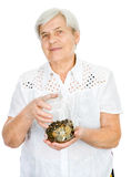 Senior woman hands holding jar with coins Royalty Free Stock Photos