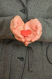 Senior woman hands with red Heart Stock Photography