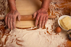 Senior woman hands rolling out dough flour with rolling pin,hom stock photos