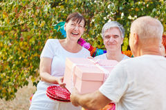 Senior woman happy about her birthday gift Royalty Free Stock Photos