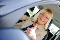 Senior woman happy At the Wheel Royalty Free Stock Photos
