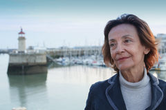Senior woman by the harbour Stock Images