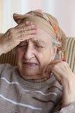 Senior woman has headache Stock Image