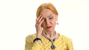 Senior woman has headache, isolated. stock video footage