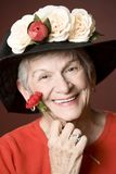 Senior woman in a hat with flowers Royalty Free Stock Photos