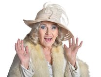 Senior woman in  hat  posing. On white background Stock Photography