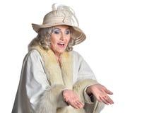Senior woman in  hat  posing. On white background Stock Image