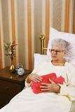 Senior woman have a belly pain Royalty Free Stock Photo