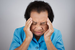 Senior woman have a headache Royalty Free Stock Photo