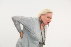 Senior woman having backache isolated. Royalty Free Stock Image