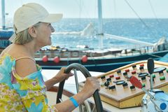Senior woman having boat ride Royalty Free Stock Photography